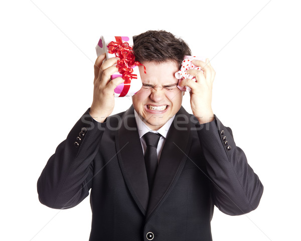 A angry man holding present box in formal black tux Stock photo © Massonforstock