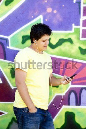 Graffiti painter drawing a picture on the wall Stock photo © Massonforstock