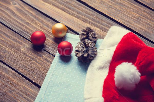 Santas hat and chrsitmas bubbles  Stock photo © Massonforstock