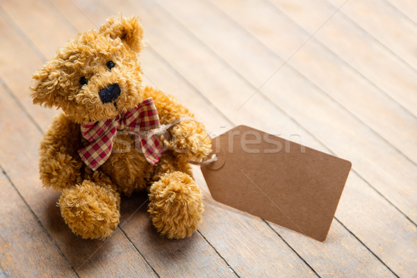 cute fluffy teddy bear with label on the wonderful brown wooden  Stock photo © Massonforstock
