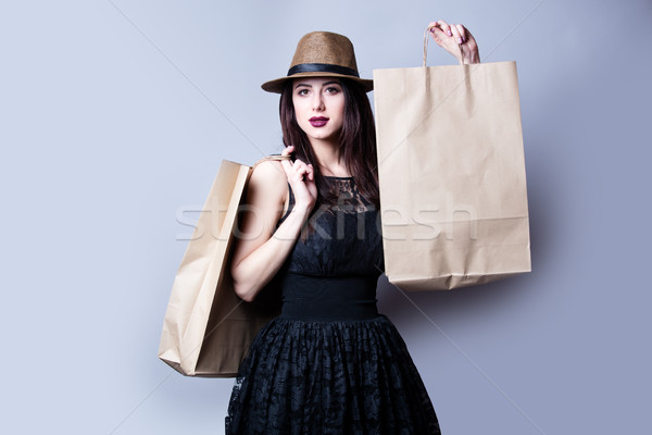 beautiful young woman with shoping bags standing in front of won Stock photo © Massonforstock