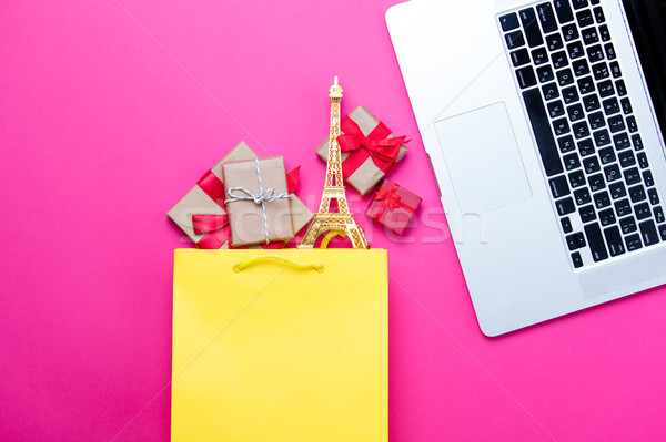 cute gifts and eiffel tower shaped toy in shopping bag and cool  Stock photo © Massonforstock