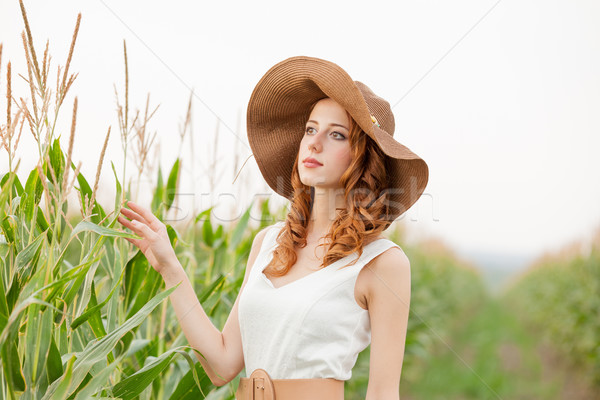 photo of beautiful young woman standing near the wheat plant  Stock photo © Massonforstock
