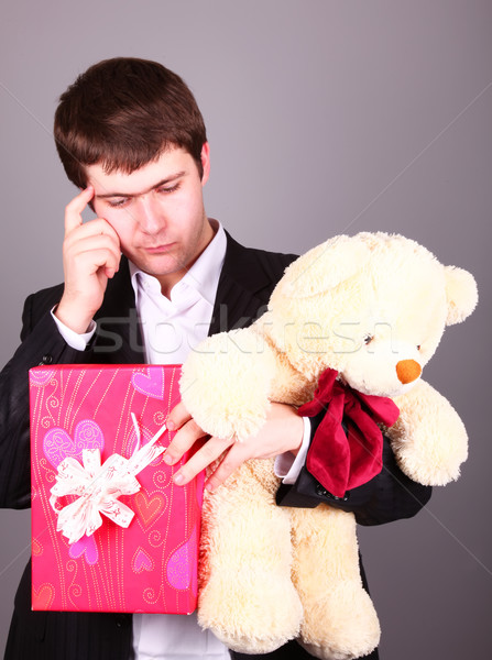 Boy with present box and teddy bear can't select a present in St Stock photo © Massonforstock
