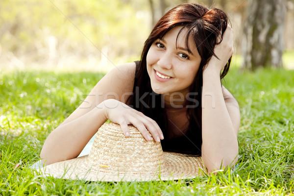 Beautiful brunette girl in hat at the park. Stock photo © Massonforstock