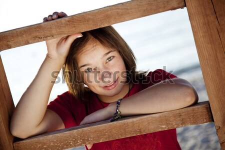 Redhead girl with heavy old suitcase. Stock photo © Massonforstock