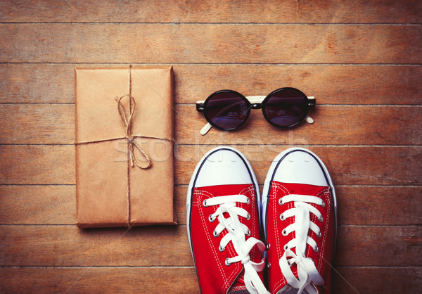 Gumshoes with sunglasses and package  Stock photo © Massonforstock
