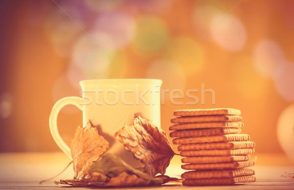 Cup tè caffè cookies giallo bokeh Foto d'archivio © Massonforstock