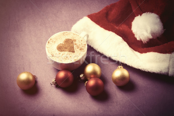 Cup of coffee with heart shape near Santas hat  Stock photo © Massonforstock