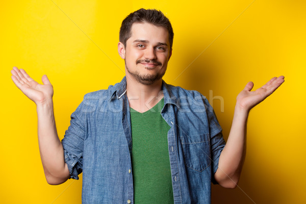 young surprised guy in shirt  Stock photo © Massonforstock