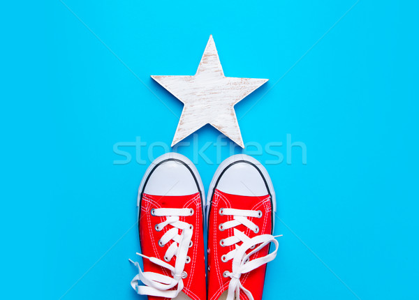 big red gumshoes and beautiful star shaped toy on the wonderful  Stock photo © Massonforstock