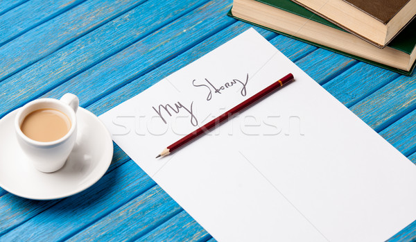 photo of paper My story, cup of coffee and pile of books on the  Stock photo © Massonforstock