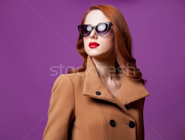 photo of beautiful young woman standing on the wonderful purple  Stock photo © Massonforstock