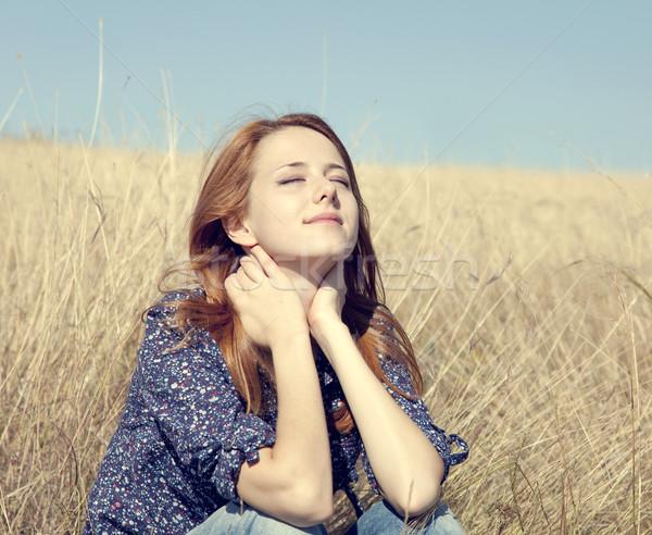 Portret gelukkig meisje najaar gras gezicht Stockfoto © Massonforstock