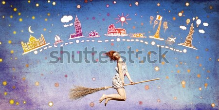 Redhead girl dreaming about traveling around the world. Stock photo © Massonforstock