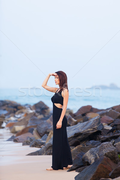 Stock photo: Portriat of Young redhead woman in a black dress