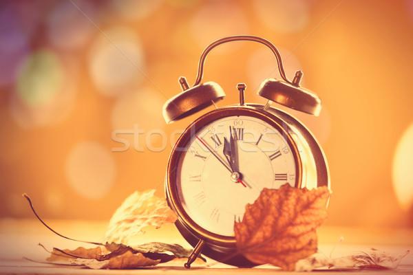 Vintage alalrm clock on yellow background Stock photo © Massonforstock