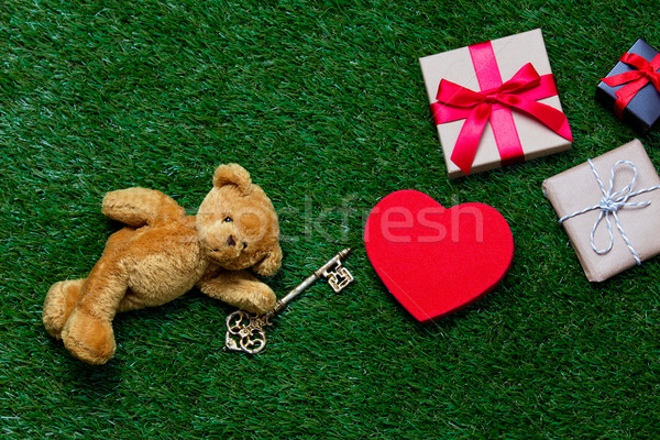 Stock photo: gifts, toy and teddy bear with key
