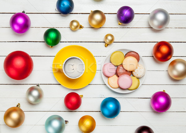 photo of yellow cup of coffee and plate full of macaroons near c Stock photo © Massonforstock