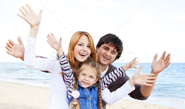 Stock photo: Young family at the beach in fall