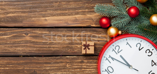 Stock photo: Gift box and clock with christmas baubles