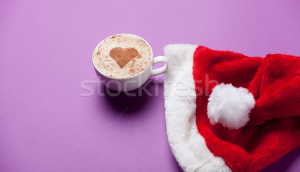 Cup of coffee and christmas hat  Stock photo © Massonforstock