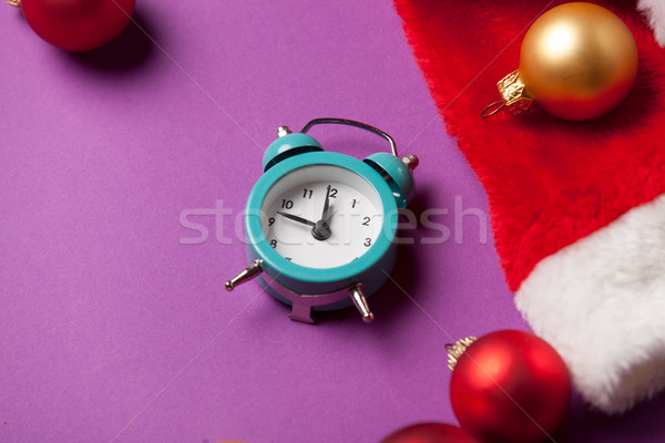 Alarm clock and Santas hat Stock photo © Massonforstock