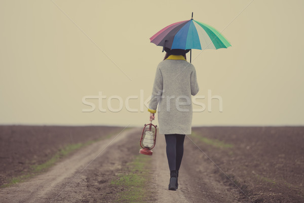 beautiful young woman with lartern and umbrella on the wonderful Stock photo © Massonforstock