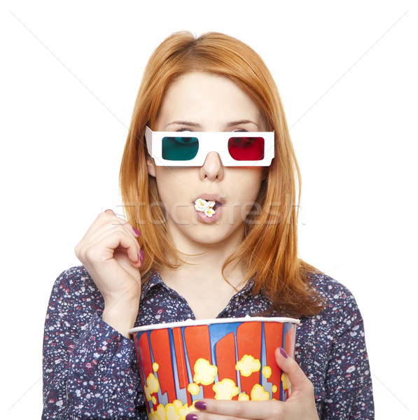 Women in stereo glasses eating popcorn.  Stock photo © Massonforstock