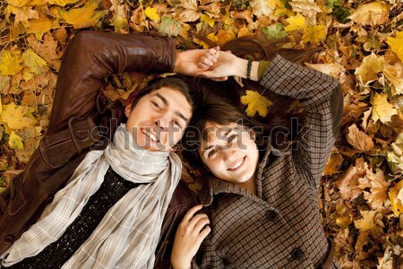 Stock photo: Three girls in the autumn park.
