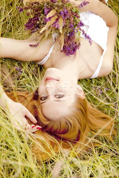 Vörös hajú nő lány szabadtér virágok fű nők Stock fotó © Massonforstock