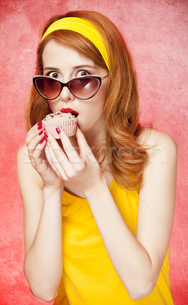 American redhead girl in sunglasses with cake. Stock photo © Massonforstock