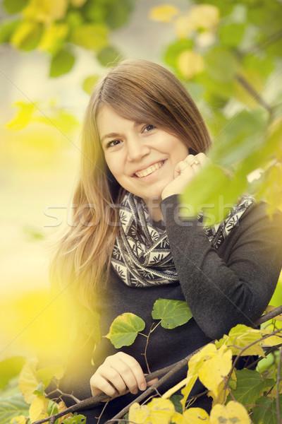 Stock photo: Beautiful girl at autumn park.
