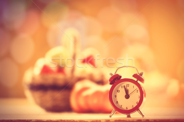 Little alarm clock and pumpkin Stock photo © Massonforstock