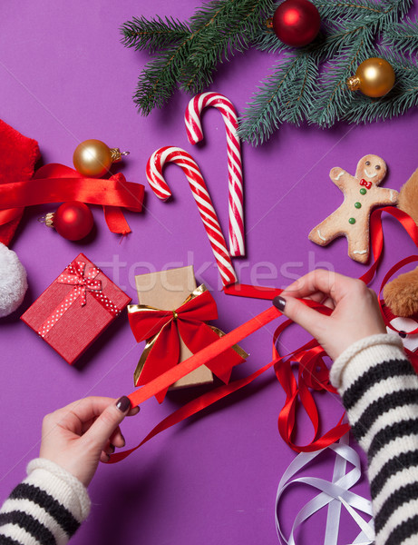 Female hands wrapping a gift Stock photo © Massonforstock