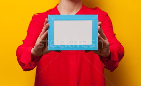Nő tart fényképkeret citromsárga fal háttér Stock fotó © Massonforstock
