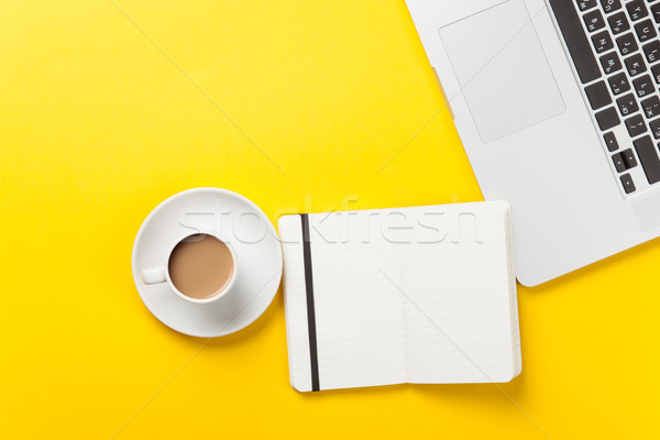 Cup and notebook near laptop comuter Stock photo © Massonforstock