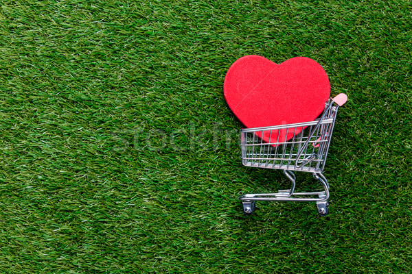 Self-service supermarket shopping trolley cart and heart shape g Stock photo © Massonforstock