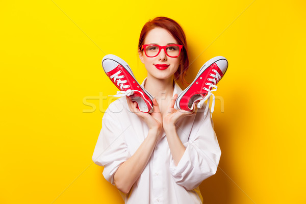 photo of beautiful young woman holding gumshoes on the wonderful Stock photo © Massonforstock