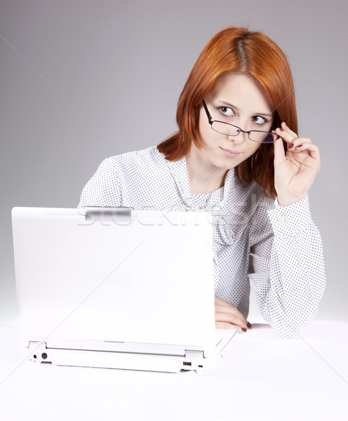 Red-haired girl with white notebook. Studio shot.  Stock photo © Massonforstock