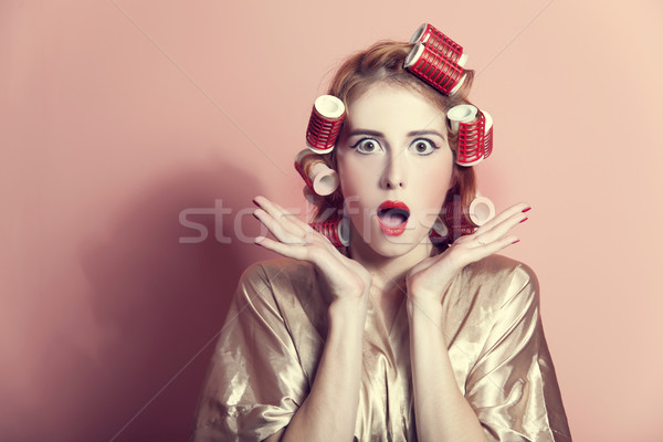 Surprised housewife with curlers Stock photo © Massonforstock