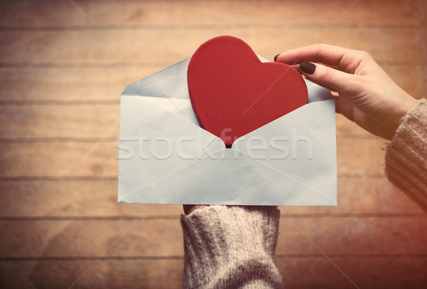 hands holding envelope and toy Stock photo © Massonforstock