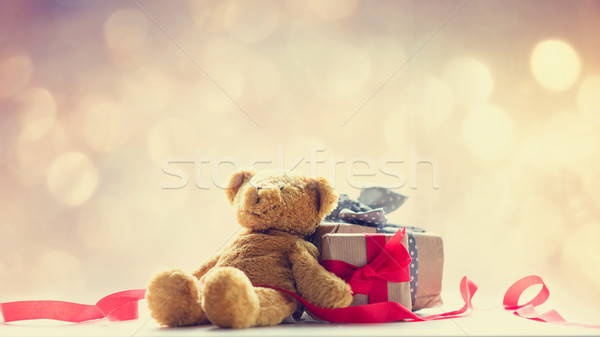 cute teddy bear, red ribbon and beautiful gifts on the fairy lig Stock photo © Massonforstock