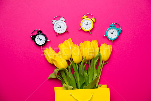 bunch of beautiful yellow tulips in cool yellow shopping bag and Stock photo © Massonforstock