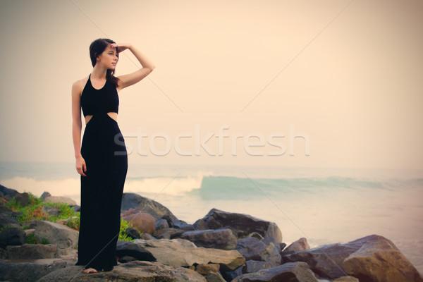 Belo mulher jovem em pé pedra costa ensolarado Foto stock © Massonforstock