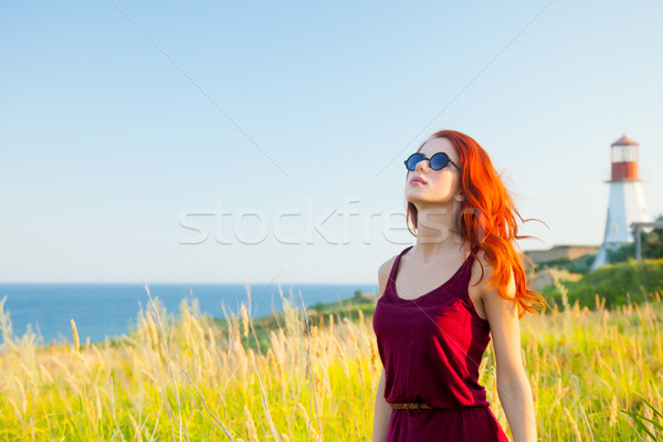 beautiful young woman standing in front of wonderful sea and lig Stock photo © Massonforstock