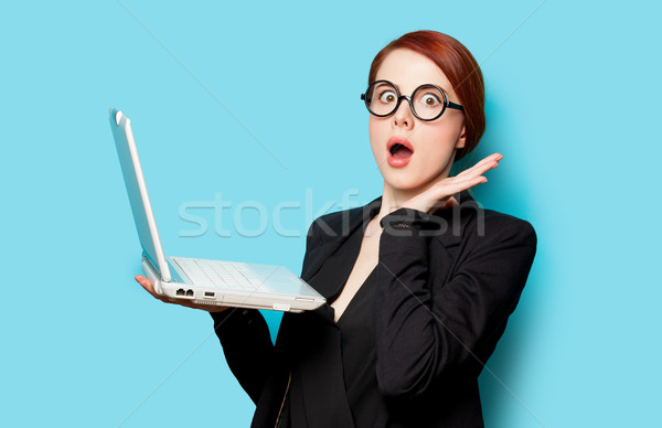 beautiful surprised young woman with laptop on the wonderful blu Stock photo © Massonforstock
