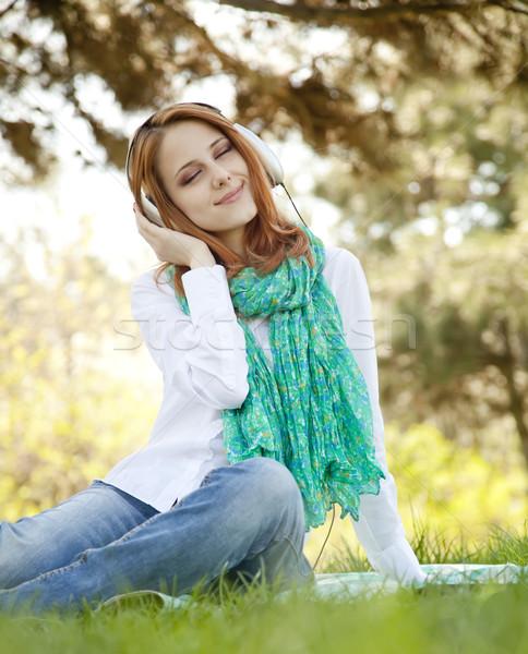 赤毛 少女 ヘッドホン 公園 音楽 ツリー ストックフォト © Massonforstock