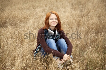 Young smiling girl with headphones at field.  Stock photo © Massonforstock