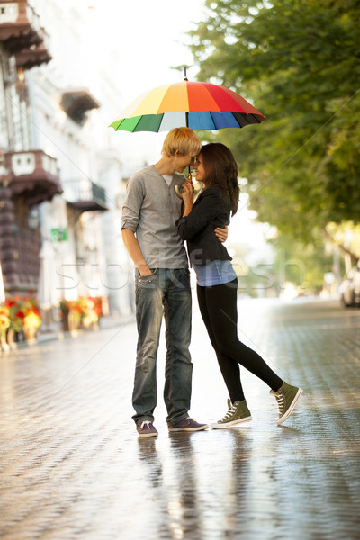 Young couple on the street of the city with umbrella Stock photo © Massonforstock
